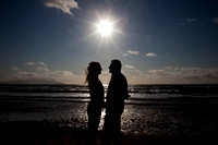 Couple sharing a kiss at sunset on beach
